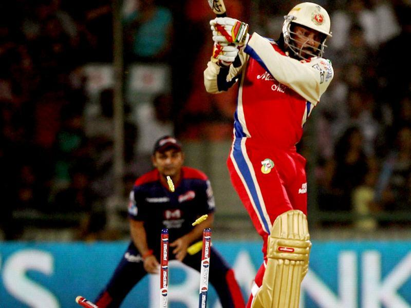 Royal Challengers Bangalore's batsman Chris Gayle being bowled by Delhi Daredevils' Irfan Pathan during T20 League match in New Delhi. PTI/Manvender Vashist