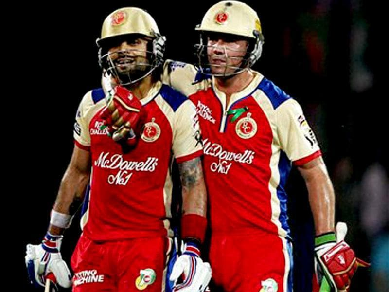 Royal Challengers Bangalore's Virat Kohli and AB devillers leaves the ground after their innings against Delhi Daredevils during T20 League match in New Delhi. PTI Photo