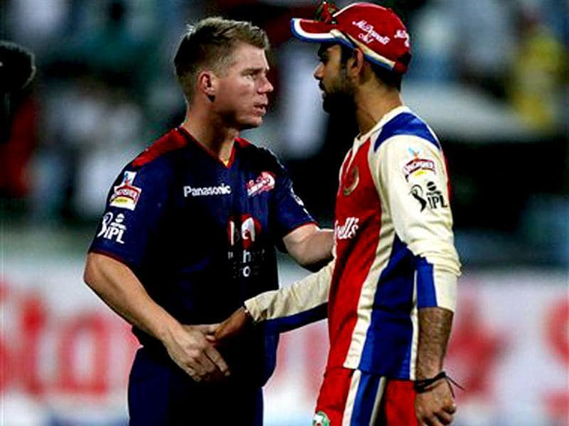 Royal Challengers Bangalore's captain Virat Kohli being greeted by David Warner after team's victory over Delhi Daredevils during T20 match in New Delhi. PTI Photo