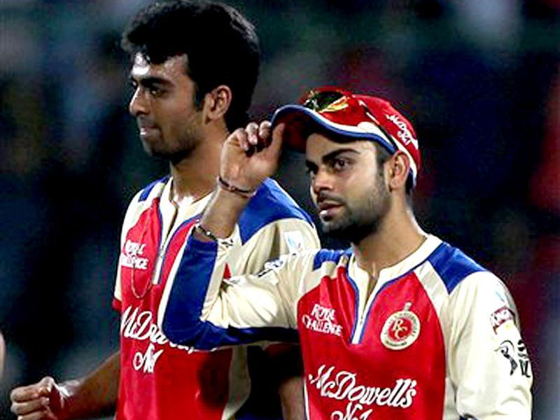 Royal Challengers Bangalore's captain Virat Kohli and Jadev Unadkat after victory over Delhi Daredevils during T20 League match in New Delhi. PTI Photo