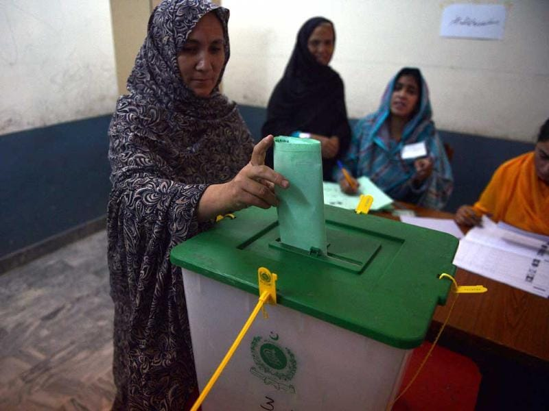 A Pakistani woman casts her vote at a polling station in Islamabad. Pakistani voters went to the polls, braving Taliban threats to cast their ballots in an election marking a historic democratic transition for the nuclear-armed state. AFP