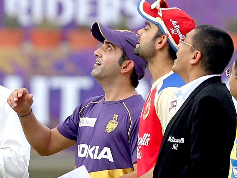 Kolkata Kinight Riders' skipper Gautam Gambhir with his Royal Challengers Banglore counterpart Virat Kohli during toss. (PTI Photo)
