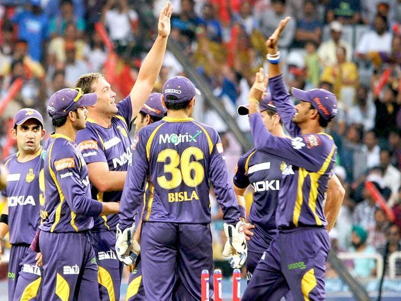 Kolkata Knight Riders players celebrate Banglore batsman Chris Gayle's during their T20 League match at JSCA International Stadium Complex, Ranchi. (PTI Photo)