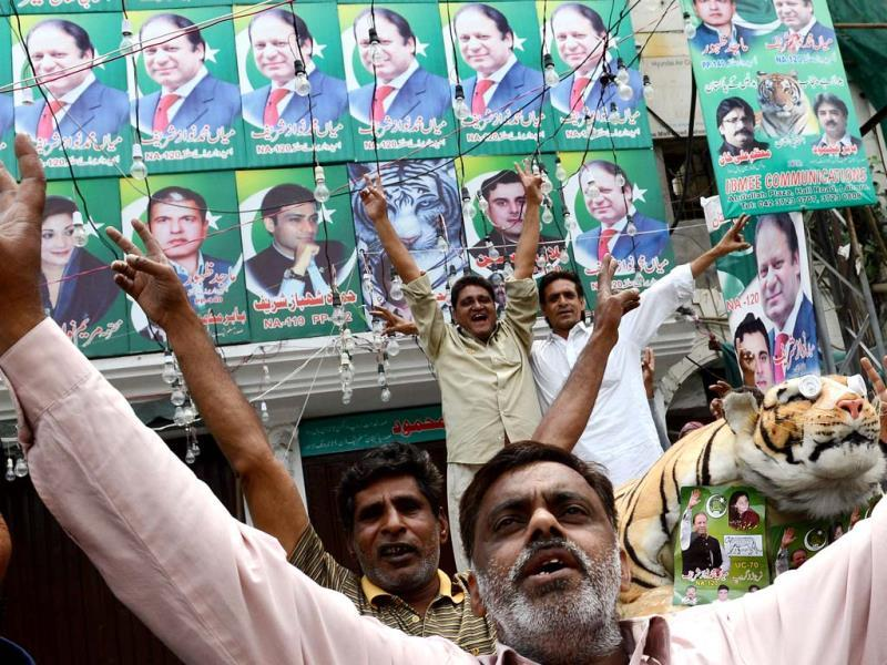 Supporters of Pakistan Muslim League-N (PML-N), Nawaz Sharif celebrate the victory of their party a day after landmark general elections, in Lahore. AFP Photo
