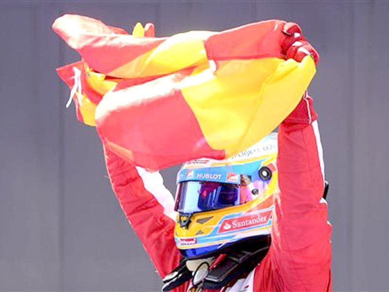 Ferrari driver Fernando Alonso of Spain celebrates his victory after wining the Formula One Spanish Grand Prix at the Catalunya racetrack in Montmelo, near Barcelona, Spain. AP Photo