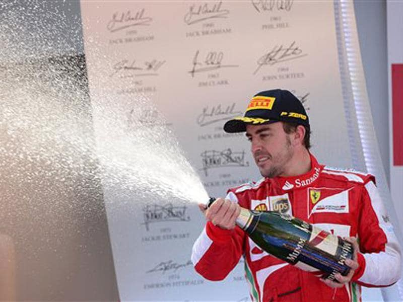 Ferrari driver Fernando Alonso of Spain sprays Champagne after winning the Formula One Spanish Grand Prix at the Catalunya racetrack in Montmelo, near Barcelona, Spain. AP Photo