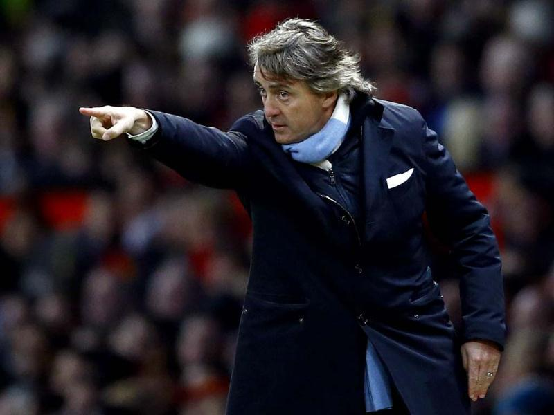 Manchester City's coach Roberto Mancini gestures during their English Premier League soccer match against Manchester United in Manchester, northern England. Manchester City sacked manager Mancini on May 13, 2013 following his team's feeble defence of the Premier League title. (Reuters/files)
