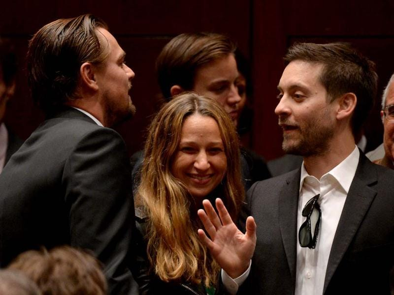 US actor Tobey Maguire and Leonardo DiCaprio talk at the 11th Hour auction at Christie's in New York. (AFP)