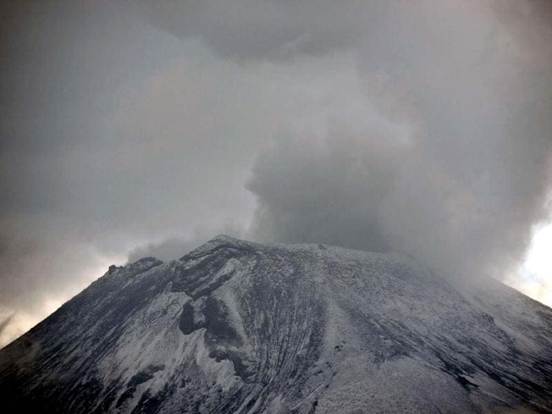 Clouds of ash and smoke are spewed from the Popocatepetl Volcano as seen from Santiago Xalitxintla, in Puebla, Mexico. (AFP)