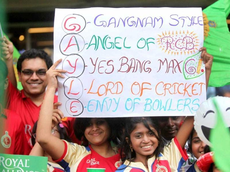 Royal Challengers Bangalore fans cheer them before the start of their T20 match against Kings XI Punjab at Chinnaswamy Stadium in Bengalore. (PTI Photo)