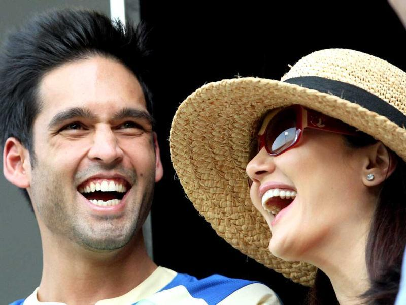 Royal Challengers Bangalore owner Siddharth Mallya shares a laugh with Kings XI Punjab co-owner Preity Zinta during the T20 match at Chinnaswamy Stadium in Bengaluru. (PTI Photo)