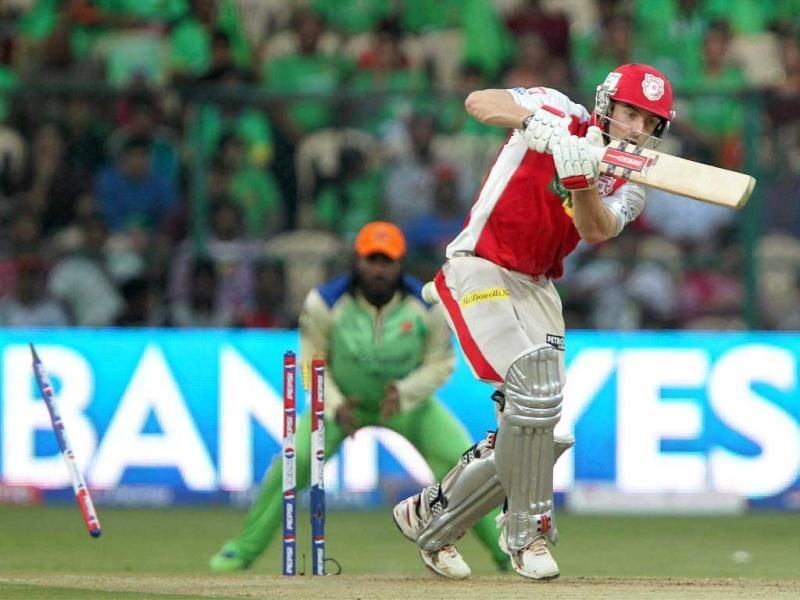 Kings XI Punjab batsman Shaun Marsh is castled during their T20 match against Royal Challegers Bangalore. (PTI Photo)