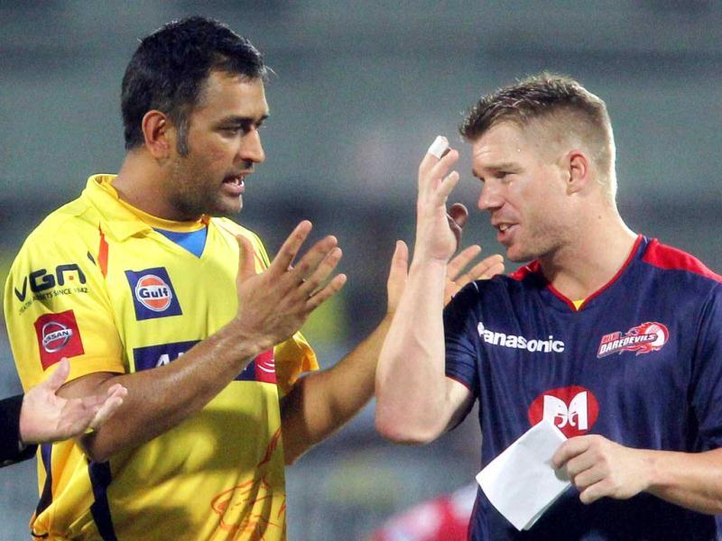 Chennai Super Kings captain MS Dhoni with his counterpart from Delhi Daredevils D Warner during their T20 match at MA Chidambaram stadium in Chennai. (PTI)
