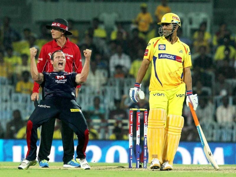 Delhi Daredevils' Roelof van der Merwe (L) celebrating Chennai Super Kings Suresh Raina's wicket as CSK's captain MS Dhoni looks on during their T20 match at MA Chidambaram Stadium in Chennai. (PTI)