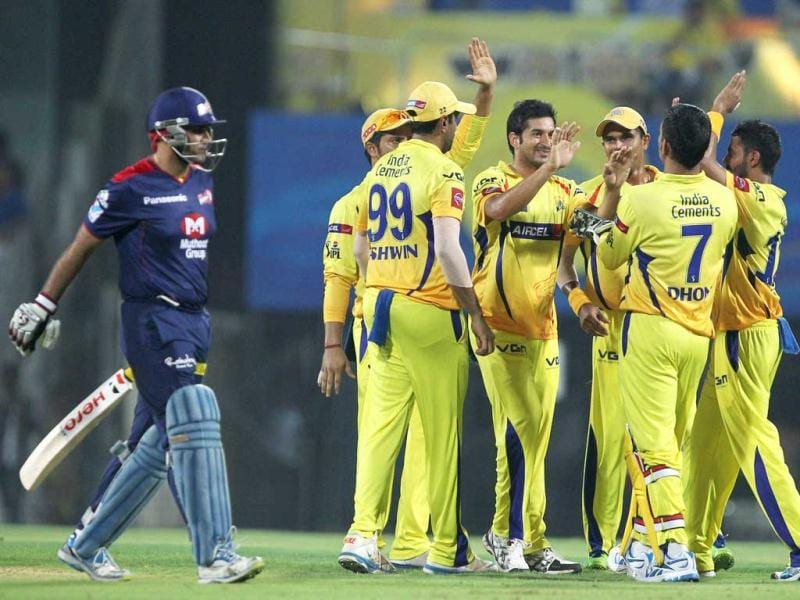 Chennai Super Kings' Mohit Sharma celebrates after taking Delhi Daredevils' Virender Sehwag's (L) wicket during the T20 match at MA Chidambaram Stadium in Chennai. (PTI)