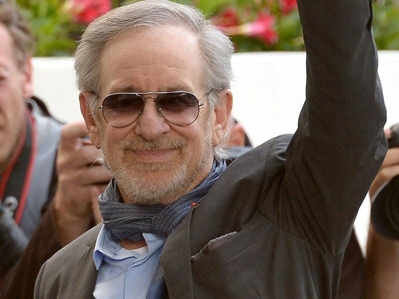 Steven Spielberg will be presiding over the feature film jury at Cannes 2013. Check out his red carpet entry. (AFP Photo)