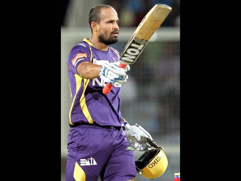 Kolkata Knight Riders' Yusuf Pathan celebrates his half century against Pune Warriors during their T20 League match at JSCA Stadium in Ranchi. (PTI Photo)