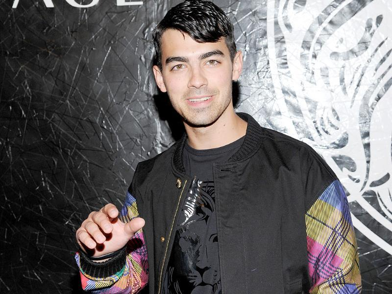 Singer Joe Jonas attends the Versus Versace and Capsule Collection fashion show at the 69th Regiment Armory in New York. AP Photo