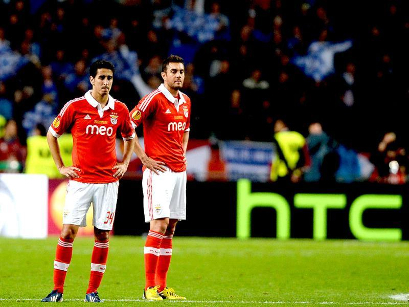 Benfica's defender Andre Almeida (L) and Benfica's Serbian midfielder Nemanja Matic react at the end of the UEFA Europa League final football match between Benfica and Chelsea at Amsterdam Arena in Amsterdam. (AFP)
