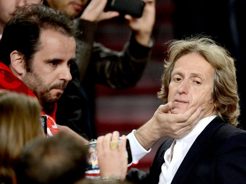 Benfica's headcoach Jorge Jesus (R) with fans after the UEFA Europa League final football match between Benfica and Chelsea on May 15, 2013 at Amsterdam Arena in Amsterdam. (AFP)