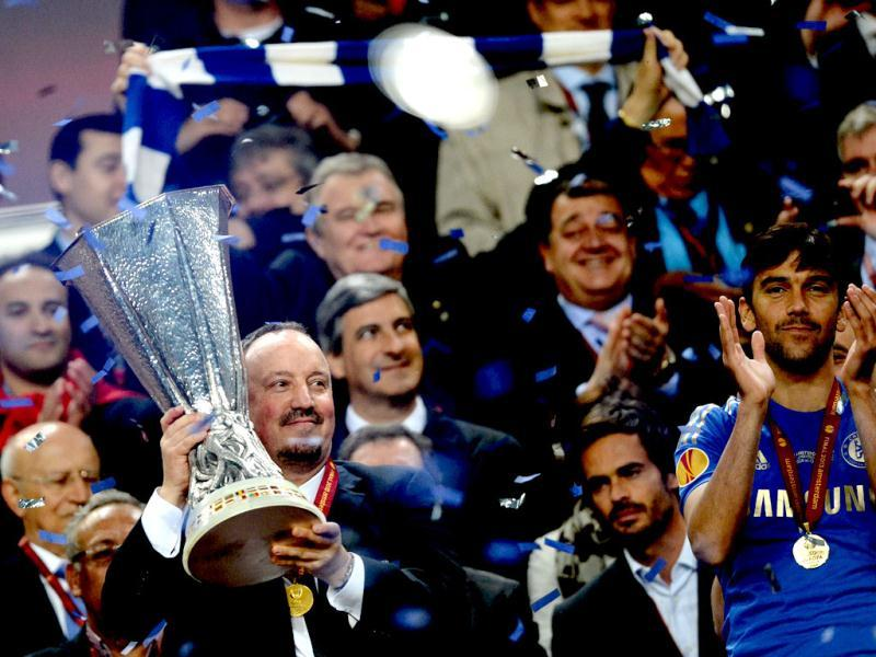Chelsea manager Rafael Benitez holds the trophy at the end of the UEFA Europa League final football match between Benfica and Chelsea at Amsterdam Arena in Amsterdam. (AFP)