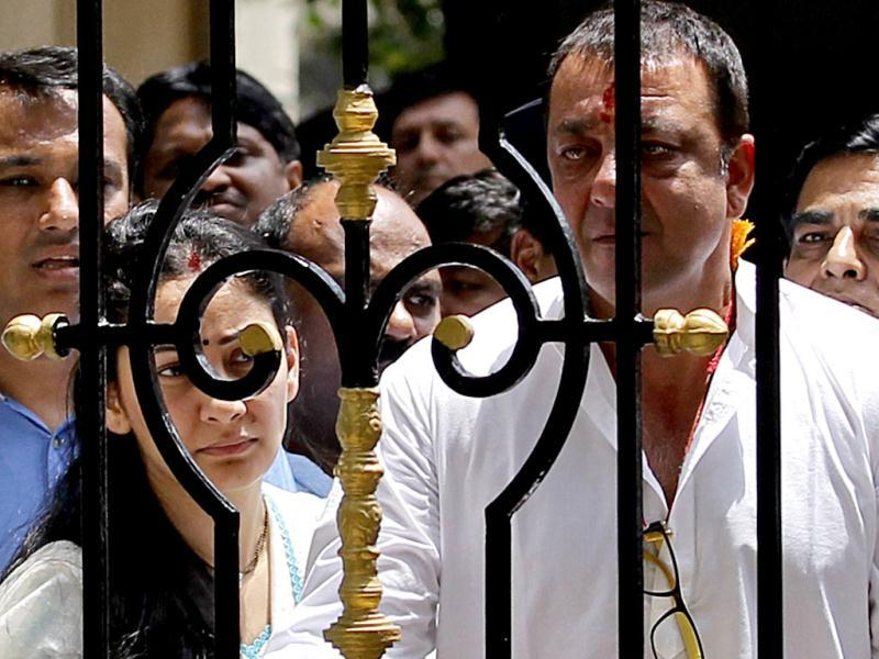 Bollywood actor Sanjay Dutt looks out from his house before leaving for TADA court in Mumbai. (Reuters)