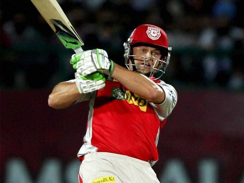 Kings XI Punjab's Adam Gilchrist plays a shot against Delhi Daredevils during their T20 match in Dharamshala. (PTI)