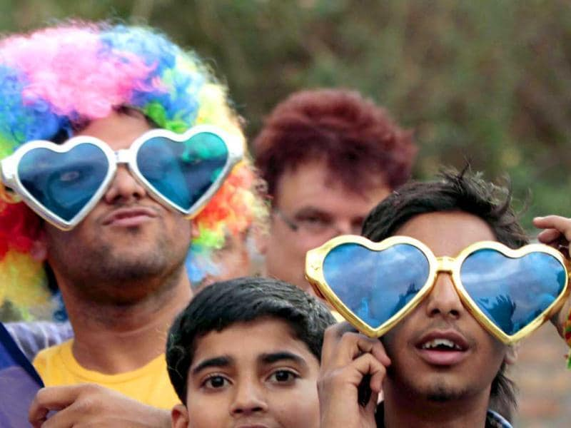 Cricket fans during a T20 match between Delhi Daredevils and Kings XI Punjab at Dharamshala. UNI