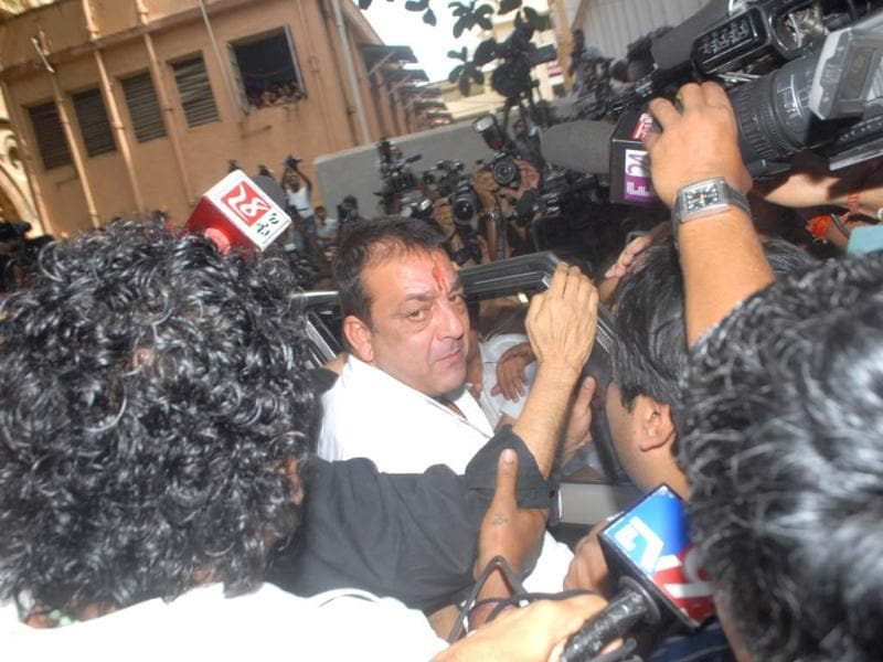 Sanjay Dutt tries to enter TADA Court in Mumbai on May 16, 2013. The crowd gathered at both the TADA Court and Arthur Road Jail was huge, with people trying to catch one glimpse of their favourite star. (Photo by Prodip Guha)
