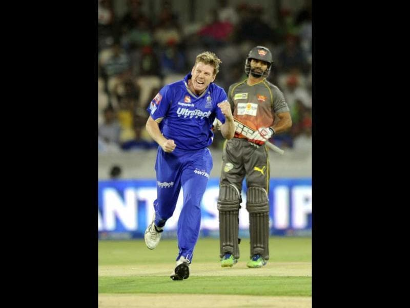 Rajastan Royals player James Faulkner celebrates with teammates after the dismissal of Sunrisers Hyderabad's batsman Shikhar Dhawan during their T20 match at the Rajiv Gandhi Cricket Stadium, in Hyderabad. (Satish Bate/HT)