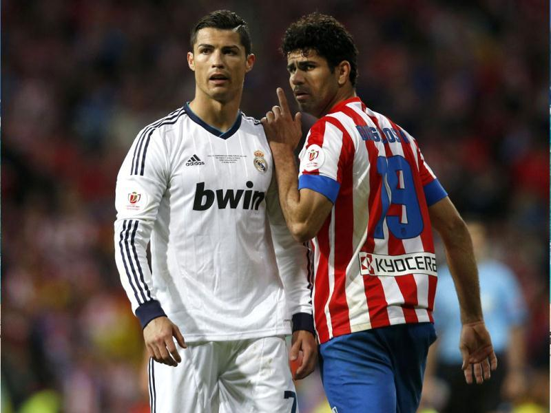 Real Madrid's Cristiano Ronaldo (L) listens to Atletico de Madrid's Diego Costa during their Spanish King's Cup final soccer match at Santiago Bernabeu stadium in Madrid. (Reuters)