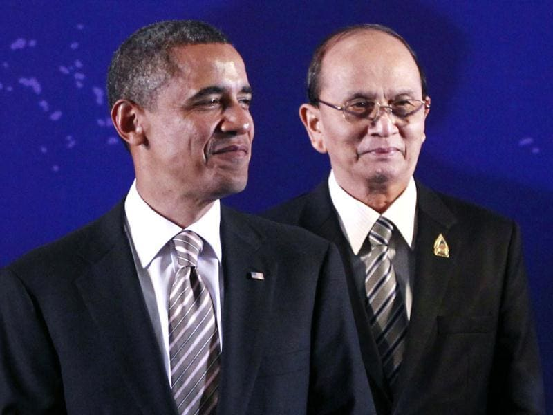 President Barack Obama, left, stands next to Myanmar President Thein Sein during a group photo session at the East Asia Summit in Nusa Dua, on the island of Bali, Indonesia. (AP Photo)