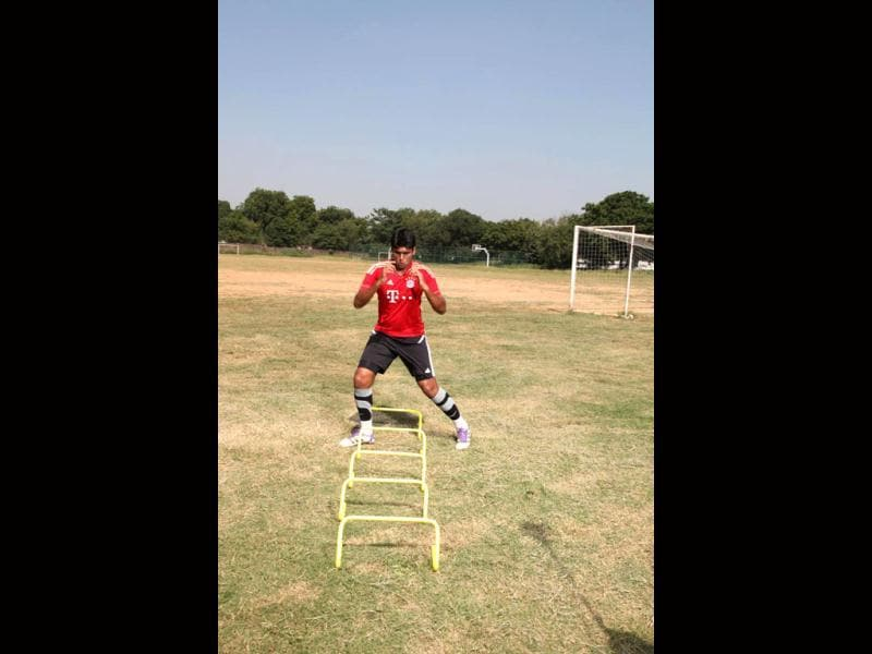 Just like the zig-zag runs between cones, this variant is done around hurdles. (Photo: Anil Chawla)