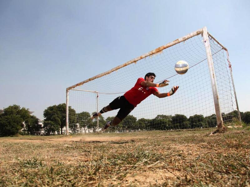 Pronoy Roy's basic workout includes circuit training for 45 minutes. There are long and short runs, jumps, drills with cones and hurdles and sand training. Only once the muscles are warm enough with these exercises, does he start the training for goalkeeping. (Photo: Anil Chawla)