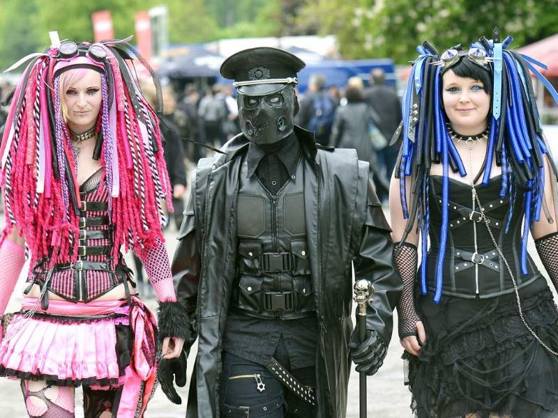 Participants of the the gothic music festival Wave Gothic Festival walk in fancy costumes in Leipzig, central Germany. AP