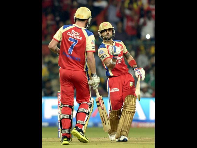 Royal Challengers Bangalore batsman Virat Kohli reacts after scoring fifty runs against Chennai Super Kings during the T20 cricket match at M Chinnaswamy Stadium, Bangalore. (Mohd Zakir/HT)