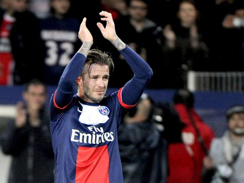 Paris Saint-Germain's English midfielder David Beckham cries after being substituted during a French L1 football match between Paris St Germain and Brest at Parc des Princes stadium in Paris. (AFP Photo)