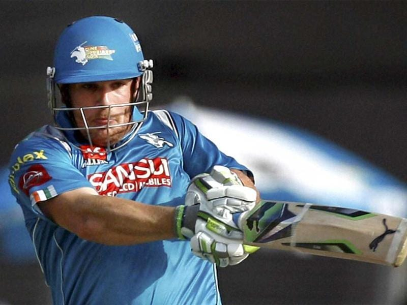 Pune Warriors batsman Aaron Finch plays a shot during the T20 match played against Delhi Daredevils in Pune. (PTI)