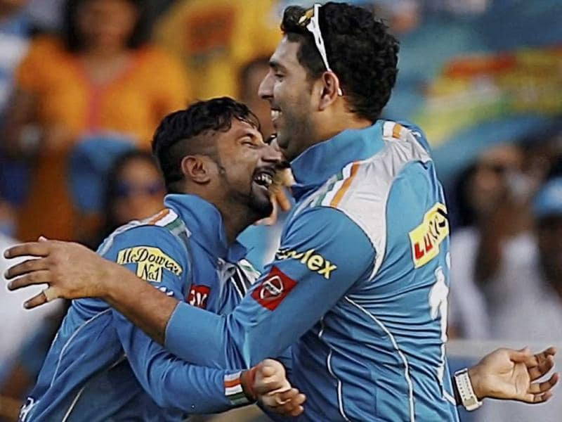 Pune Warriors bowler Ali Murtaza celebrates after taking the wicket of Virendra Sehwag during a T20 match against Delhi Daredevils in Pune. (PTI)