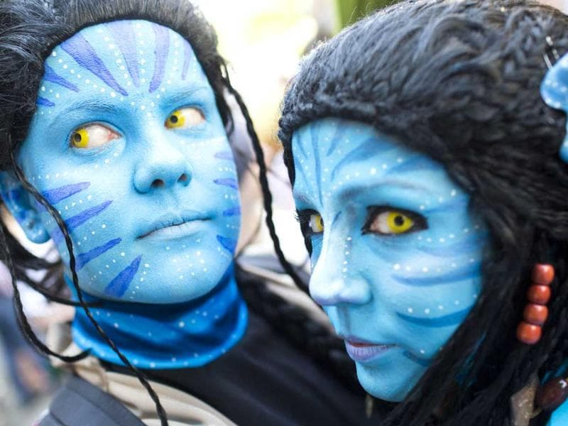 Revelers dressed as Neytiri from the movie Avatar pose during the Carnival Of Cultures parade in Berlin, Germany. Some 75 groups representing different countries from allover the world take part in the parade and tens of thousands of spectators gather along the streets. AP
