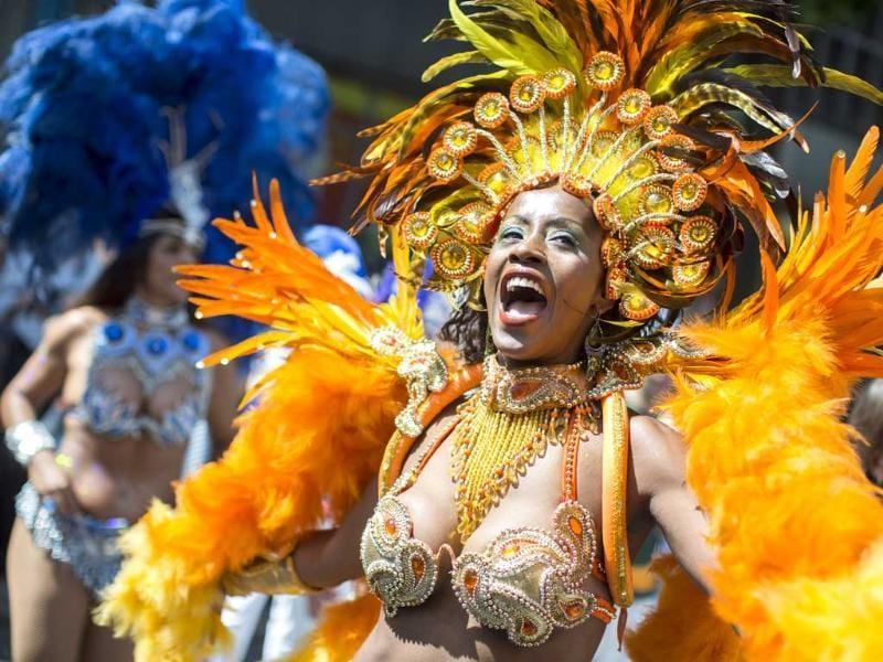 A dancer representing Brazil performs during the Carnival Of Cultures parade in Berlin, Germany. AP