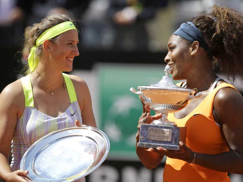 Serena Williams, of the United States, right, flanked by Belarus' Victoria Azarenka poses with the trophy after winning her final match at the Italian Open tennis tournament in Rome. AP Photo