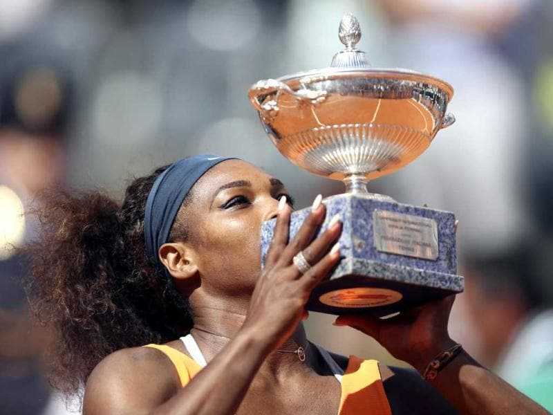 Serena Williams of the US kisses the trophy after winning the women's singles final match against Victoria Azarenka of Belarus at the Rome Masters tennis tournament. Williams won 6-1 6-3. REUTERS