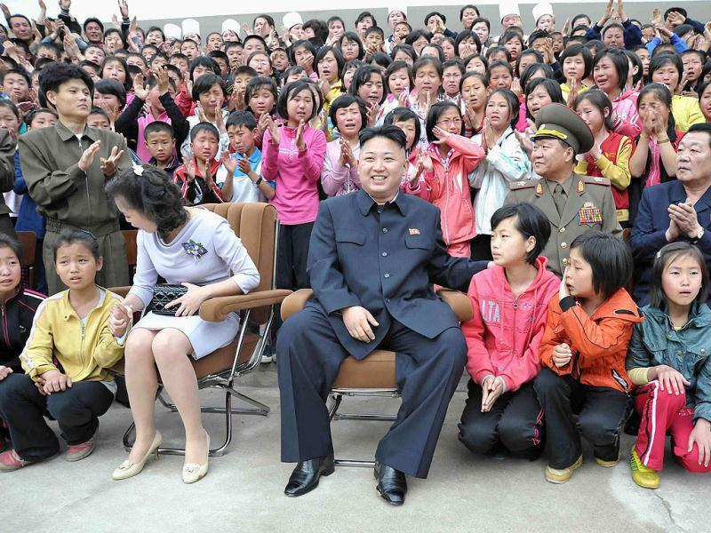 North Korean leader Kim Jong-un and his wife Ri Sol-ju sit during a visit to the Pyongyang Myohyangsan Children's Camp situated at the foot of Mt. Myohyang in North Phyongan Province. Reuters