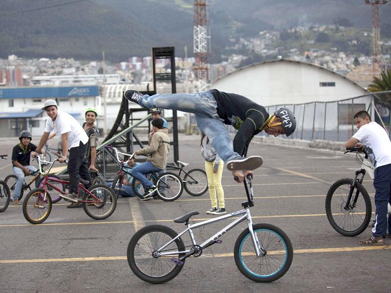 People practice stunts on their bicycles on the tracks of Quito's Old Mariscal Sucre International Airport in Tababela. Reuters