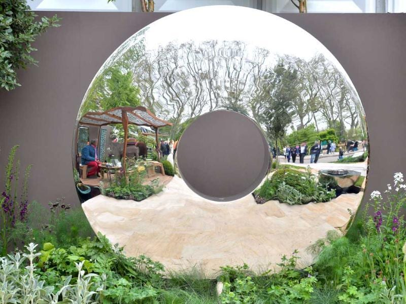 A large mirrored garden ornament is seen during the Chelsea Flower Show press day in London. The world-famous gardening event run by the Royal Horticultural Society (RHS) is celebrating its centenary year. AFP Photo