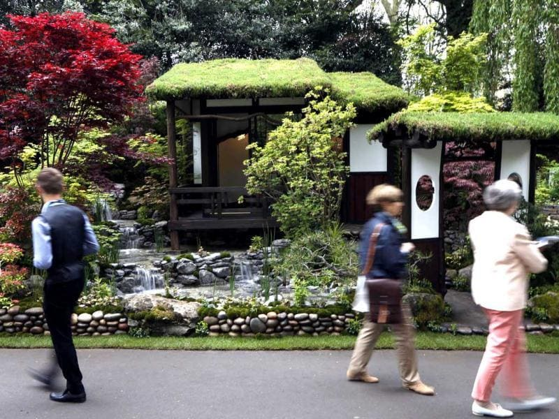 Visitors look at an artisan garden 'An Alcove (Tokonoma) Garden', designed by Kazuyuki Ishihara, during the Chelsea Flower Show in London. AP Photo