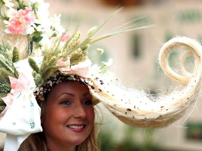 A woman wears a hat made from flowers during media day at the Chelsea Flower Show in London. Reuters