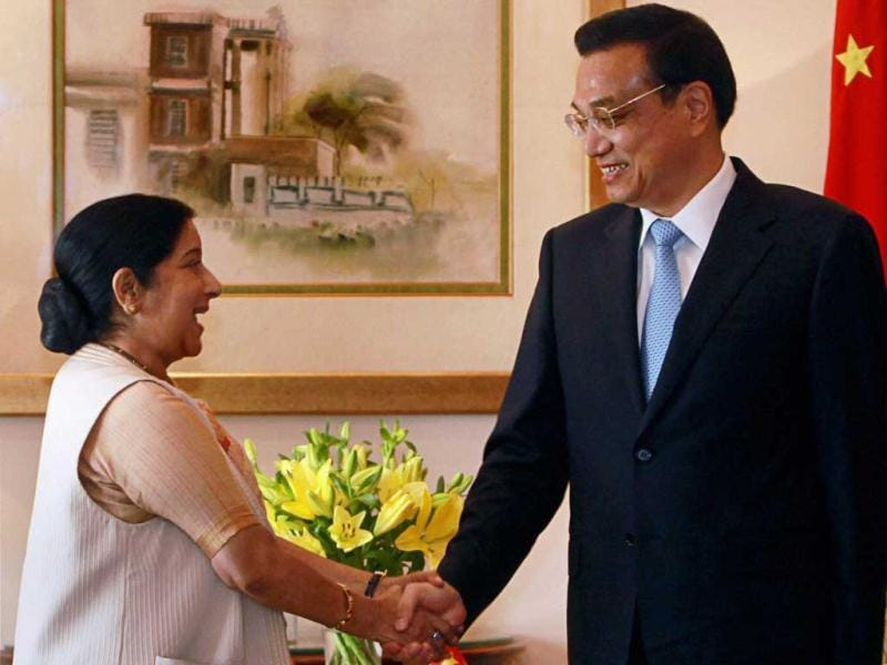 Chinese Premier Li Keqiang and leader of opposition in Lok Sabha Sushma Swaraj shake hands at a meeting in New Delhi. PTI Photo