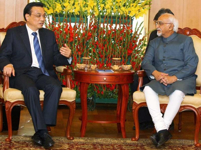 Vice President Hamid Ansari (R) talks with Chinese Premier Li Keqiang during a meeting in New Delhi. PTI Photo